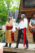 MUSKOGEE, OK - MAY 24: A man dressed in pirate costume sings the Oklahoma 19th annual Renaissance Fe