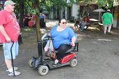 MUSKOGEE, OK - MAY 24: Woman in a wheelchair enjoys her day at the Oklahoma 19th annual Renaissance Festival on May 24, 2014 at the Castle of Muskogee in Muskogee, OK.