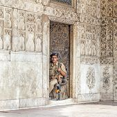 Policeman Pays Attention In The Red Fort To Protects Visitors From Crime