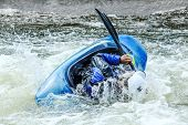Kayak on whitewater. Focus on back of kayak and water
