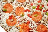 Raw Pepperoni Pizza With Sausage And Chopped Pepper