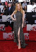 LOS ANGELES - APR 13:  Leslie Mann arrives to the 2014 MTV Movie Awards  on April 13, 2014 in Los Angeles, CA.
