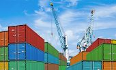 foto of ship  - export or import shipping cargo container stacks and port cranes - JPG