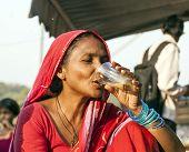 woman drinks tea at the Meena Bazaar Market