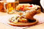 eisbein with braised cabbage, salad and beer