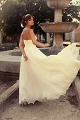 Beautiful Bride In Elegant Wedding Dress Posing At Park