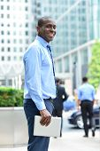 Smiling Man Standing Outside Offices Building
