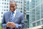 Smiling Businessman Using His Smartphone