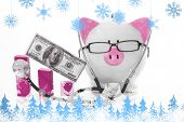 Snowflakes and fir trees against pink and white piggy bank wearing glasses and stethoscope