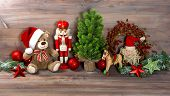stock photo of nutcracker  - nostalgic christmas decoration with antique toys teddy bear and nutcracker - JPG