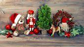 stock photo of nutcrackers  - nostalgic christmas decoration with antique toys teddy bear and nutcracker - JPG