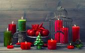 Christmas Background With Birdcage And Burning Candles