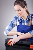 Young Repairwoman At Work