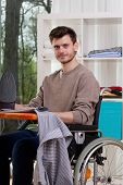 Disabled Man With Ironing Board