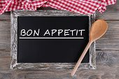 Bon appetit written on chalkboard, close-up