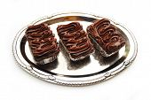 Three Gourmet Brownies Served On A Silver Platter