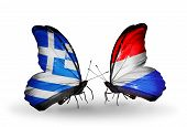 Two Butterflies With Flags On Wings As Symbol Of Relations Greece And Luxembourg