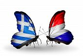Two Butterflies With Flags On Wings As Symbol Of Relations Greece And Holland