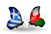 Two Butterflies With Flags On Wings As Symbol Of Relations Greece And Oman