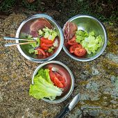 raw food in metal bowls in nature