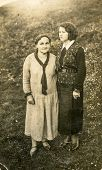 LIPINY, POLAND  MAY 21, 1931: Vintage photo of two women outdoor