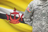 American Soldier With Flag On Background - Brunei