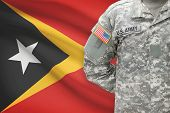 American Soldier With Flag On Background - East Timor