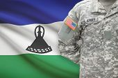 American Soldier With Flag On Background - Lesotho