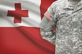 American Soldier With Flag On Background - Tonga