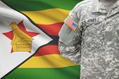 American Soldier With Flag On Background - Zimbabwe