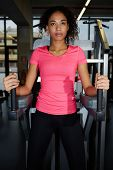 Portrait of an attractive afro american girl having a rest after workout at gym