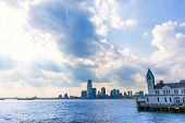 Pier A in Battery Park Manhattan skyline New York and Jersey with dramatic sky