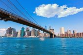 Brooklyn Bridge and Manhattan skyline New York city sunshine US