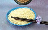 Blue Plate With Rice And Chopsticks