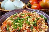 stock photo of anti  - Vietnamese food tomato saute egg popular Vietnam food in Viet Nam meal ingredient as egg tomato season with scallion pepper verry nutrition cheap dish for diet or vegeterian anti cancer - JPG