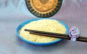 Plate With Rice And Chopsticks