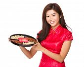 Asian woman show with snack tray