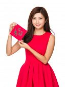 Woman hold with Fai Chun for chinese new year, word meaning is good blessing for you