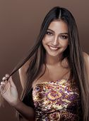 cute happy young indian woman in studio close up smiling, fashio