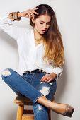 Girl posing in studio on gray background