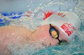 GRAZ, AUSTRIA - APRIL 05, 2014: Michael Scherer (Austria) competes in the men's 400m freestyle event in an indoor swimming meeting.