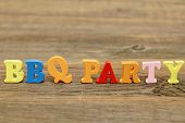 stock photo of bbq party  - Sign BBQ Party From Wood Letters on the Grunge Wooden Board - JPG