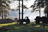 image of tractor  - in the summer morning the tractor goes to hay cleaning  - JPG