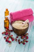 picture of salt-bowl  - Spa setting with sea salt soap towel and flower on aqua painted wooden boards - JPG