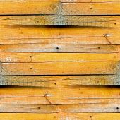 seamless texture of the wooden fence of the old yellow