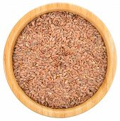 Brown Flax Seeds In Wooden Bowl Isolated.