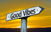 Good Vibes sign with a sunset background