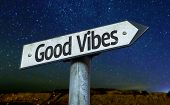 Good Vibes sign with a beautiful night background