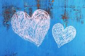 Hearts drawn of chalk on wooden background close-up