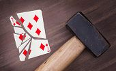 Hammer With A Broken Card, Seven Of Diamonds
